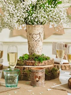 Whilst green might not be a colour you'd usually associate with weddings, it's the secret ingredient for that woodland feel you're after. We've teamed moss with a spray of playful ivory flowers to lift the otherwise neutral tones.