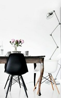 Antique table combined with a modern classis - Eames plastic chair.