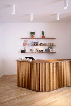 another check out idea. we could get wood dowels from woodgrain and do this.  French Trotters flagship store, Paris store design