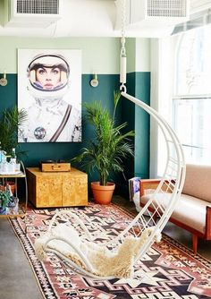 While we always assumed that a hanging rattan chair was best suited to a beach house porch or a kids' room, we instantly changed our minds after laying eyes on Carlson Young's Downtown L.A. loft....