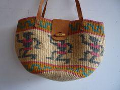 Kenya Woven Bag  https://www.etsy.com/listing/190597505/woven-kenya-bag-straw-bucket-bag-vintage?ref=listing-5  #kenyabag #strawbag #wovenbag #tribalbag #beachbag #beach #summer #womensfashion #summerfashion #unique #african #tribal #leather #leatherbag #diaperbag #woven