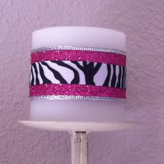 Easy zebra and hot pink candle. Just layer zebra ribbon over hot pink ribbon and secure with a dab of hot glue!