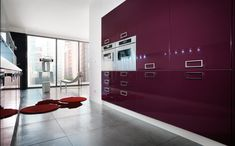This mauve colored kitchen is from the Slim Collection and there are more colors available. There are many options to make full use of your kitchen like with these floor to ceiling cabinets. You can store away all the kitchen gadgets and spices from view.