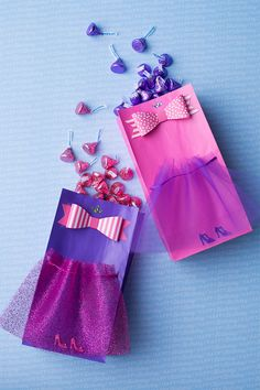 DIY Princess Goodie Bag — Princess-themed goodie bags filled with HERSHEY'S Birthday party favors are the only way to end your KISS-ational princess birthday. What you'll need: HERSHEY'S Birthday candy, colored bags, colored tulle, ribbons and princess stickers. Glue the tulle to the bag, decorate with ribbons and stickers, fill, and the bag is fit for the ball! Let's make your child's party the sweetest celebration ever, with HERSHEY'S Birthday candy. Let's Birthday!