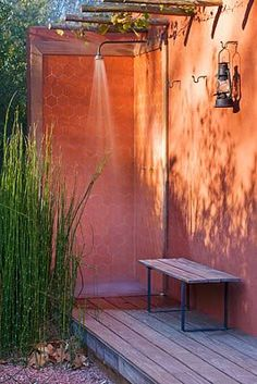 AFRICAN GARDEN, PROVENCE, FRANCE: DESIGNER DOMINIQUE LAFOURCADE: OUTDOOR SHOWER