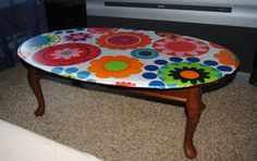 1960's Inspired Decoupage coffee table made with fabric and Modge Podge.  Great way to salvage a damaged table top.