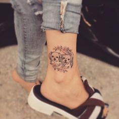 dog tattoo on foot