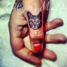 Cat finger tattoo