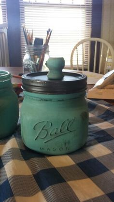 "Waverly ""agave"" chalk paint over mason jar, sanded and aged with dark and light waxes. Lid spray painted with Rustoleum oil rubbed bronze."