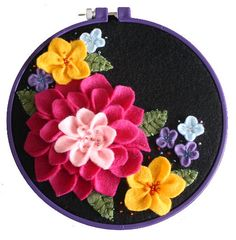 Vintage inspired felt flowers - NEEDLEWORK. author refers to:http://twinfibers.blogspot.com/2009/11/vintage-felt-embroidery.html and immediately fell in love. I also found a great tutorial on making a dahlia type flower here http://news.holidash.com//2010/04/23/mothers-day-corsage/,