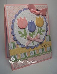 By Vicki Burdick. Easter card. Tulip petals were punched out using the wing of the Stampin' Up Bird Builder punch. Punch 3 petals, sponge edges with ink, and layer together to make one tulip. Use the leaf from the same punch to make the stems. Background could vary.