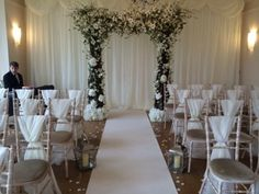 Floral Arch dressing the entrance to the aisle at Coombe lodge