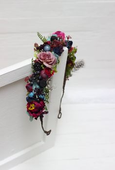 Flower crown is decorated with fabric flowers , berries ,feathers . Details -Length of wreath is 18.9 inches (48 cm) - It is regulated by a satin ribbon. -The wreath is flexible. At the base is wire wrapped with a floral tape. Invite you to visit my shop : https://www.etsy.com/shop/ByKochetova Thanks for visiting