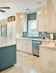 Love the blue & the top glass cabinets ! White cabinets with Backsplash & island same color!  That's how you pull it together... Lol