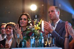 The couple clap as they listen to a speech during tonight's glittering reception. Clearly visible on Kate's left hand was her sapphire engagement ring which once belonged to the Princess of Wales, which she teamed with pearl bracelets