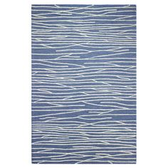 Add a pop of pattern to your living room or den with this hand-tufted wool and art silk rug, showcasing a striped motif for stylish appeal. ...