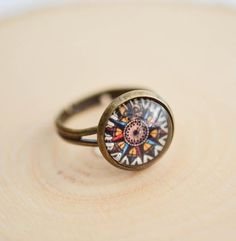 This beautiful compass ring is made from a high quality print attached to a bronze adjustable ring | Find more gypsy jewelry and boho accessories here! Outfits, Outfit Ideas, Outfit Accessories, Cute Accessories