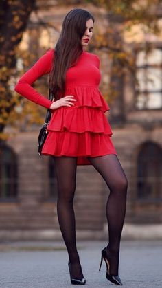 Red dress with flounces black tights and high heels - As first seen on blog Help! I have nothing to wear: Red dress with flounces black tights and high heels She is wearing tights similar here: Black Semi Opaque Tights Enjoy luxury on the skin with no visible lines. This revolutionary collection is perfect for underneath fitted skirts and dresses. #tights #pantyhose #hosiery #nylons #tightslover #pantyhoselover #nylonlover #legs #blackhighheelswithtights #highheelslegs