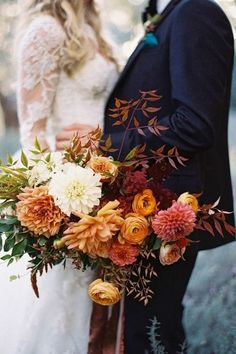 Autumn bridal bouquet with mums, ranunculus, garden roses and foliage                                                                                                                                                                                 More