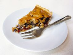 """Scottish food: the famous Ecclefechan Butter Tart You thought I was done with the Scottish food? Guess again! It's the Ecclefechan Butter Tart! This is similar to one of the first sweet tarts I ever learned to make, called """"Border Tart… Scottish Desserts, Scottish Dishes, Scottish Recipes, Irish Recipes, Tart Recipes, Baking Recipes, Dessert Recipes, Sweet Pie, Sweet Tarts"""
