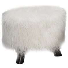Add a pop of style to your living room or master suite with this chic ottoman, showcasing faux fur upholstery and black wood legs.    P...