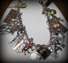 INSPIRED Twilight Saga New Moon Eclipse Breaking Dawn Bella Edward Jacob Vampire Wolf Charm Bracelet. $25.00, via Etsy.