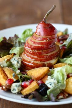 Fall Harvest Salad - Roasted butternut squash, ripe pears, buttery pecans, salty blue cheese, thick dried cherries, and juicy pomegranate seeds mixed in an easy Maple-Cider vinaigrette.