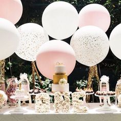 pink and white wedding balloons are nice decor of dessert table