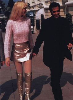 Claudia Schiffer wearing Gianni Versace with David Copperfield in 1994