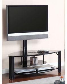 """TV Fendy 50"""" Black Finish With Black Tempered Glass And Mound Braket Included TV Console. This simple and straightforward TV console comes complete with a mount bracket and is perfect for small spaces. Solidly constructed in a black finish and accented with black tempered glass this is the perfect streamlined approach to home entertainment.  www.1800sofas.com/Living-Rooms/media-storage/foa-cm5129-tv-fendy-50-black-finish-with-black-tempered-glass-and-mound-braket-included-tv-console"""
