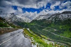 winter in july by TimDavis8  Alps Winding road Snow shower Swiss ALps Swiss Alps snow storm in July TimDavis8