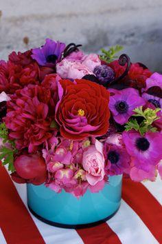 hydrangea, anemones, peonies, garden roses, mint, fiddlehead fern, ranunculus, scented geranium, and handmade paper flowers.