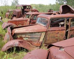 Line of rusted cars that have been abandoned