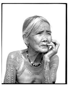 """""""Up in the rice terraces of the Cordillera mountain range of the Philippines live the last few tattooed women of Kalinga..."""""""