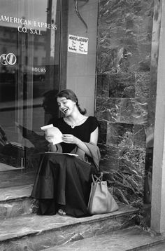 """Ruth Orkin Jinx Reading Her Mail at the American Express Office, Florence, from the """"American Girl in Italy"""" Series 1951 American Girl, Documentary Photographers, Famous Photographers, Image Photography, Street Photography, People Photography, Portrait Photography, Fashion Photography, Thomas Bernhard"""