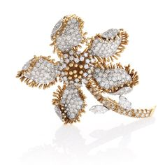 American Mid-Century Gold and Platinum Flower Brooch.  Available exclusively at Macklowe Gallery.