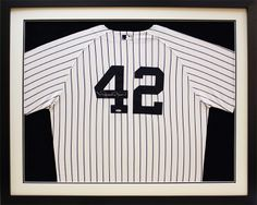 Framed sports jerseys always look great in a man cave.  Especially NY Yankees!  Custom frame design by Art and Frame Express in central NJ at our Edison location.