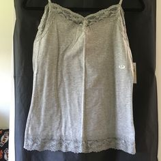 Grey Van Heusen Camisole with Lace Detail - NWT Grey Van Heusen camisole with beautiful lace detail on top and bottom. Wrinkled from being in my closet, but item is NWT. Van Heusen Intimates & Sleepwear
