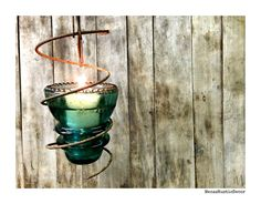 Hey, I found this really awesome Etsy listing at https://www.etsy.com/listing/107577477/unique-hanging-glass-insulator-votive