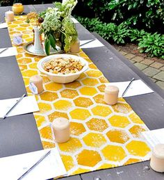 DIY honeycomb table runner by cutting out hexagaon shaped sponges in two different colors and printing over canvas cloth. love it! and i love the texture