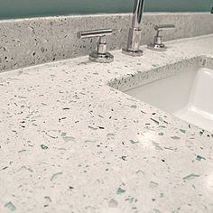 I love this counter.  It's a mix of cement, sand, pebbles and glass, all poured into a custom made mold.  Very cool.