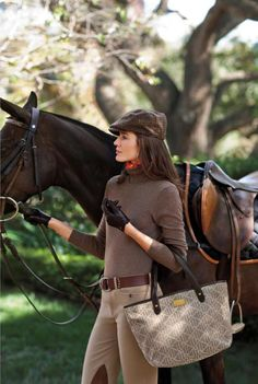 Ralph Lauren... because all girls take their handbags when they go riding. ha!