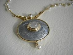 Silver gray enamel and engraved pendant in 18ct yellow gold and silver, set with moonstone and pearl.