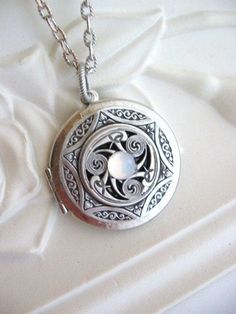 Moonstone locket...pinned by ♥ wootandhammy.com, thoughtful jewelry.