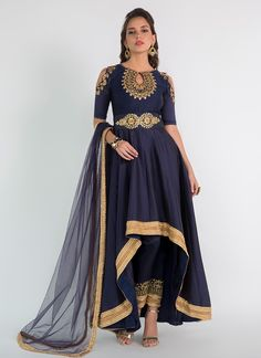 Navy Blue High Low Embroidered Anarkali features a gorgeous taffeta silk top alongside a taffeta bottom and inner. A net dupatta completes the work. Embroidery work is completed with zari, stone, and lace. Party Wear Indian Dresses, Party Wear Lehenga, Indian Fashion Dresses, Indian Gowns, Indian Attire, Indian Wear, Bridal Dresses, Pakistani Frocks, Pakistani Dress Design
