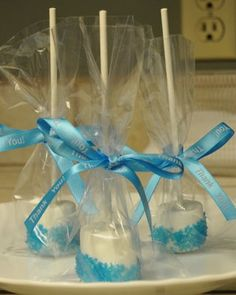 marshmallow pop favors - much easier than cake pops.   Think I'll dip them in chocolate though.