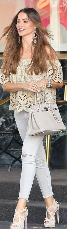 Who made  Sofía Vergara's tan eyelet off the shoulder top, platform sandals, and beige tote handbag?
