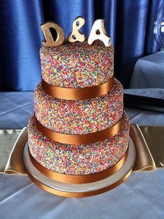 Sprinkles Wedding Cake - 3 tiers of chocolate mud cake, chocolate ganache and sprinkles  the bride said it was perfect - just like eating a giant freckle!!!