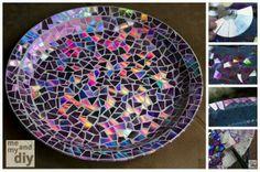 http://diycozyhome.com/recycled-dvd-mosaic-birdbath
