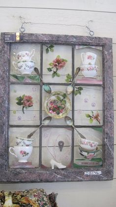 Beautiful artistic display of tea cups, teaspoons, and other little things...